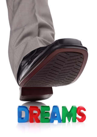 walking shoes: Businessman foot about to tread on someones dreams concept for broken dreams, bullying or oppression
