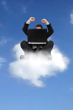 good news: Busnessman sitting on cloud with laptop computer concept for cloud computing or on cloud 9