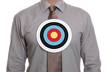 sales person: businessman with a target symbol on his chest concept for sales target or targeting a person Stock Photo