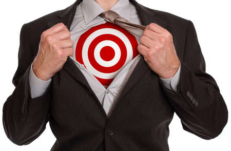 Businessman in classic superman pose tearing his shirt open to reveal target symbol on chest photo