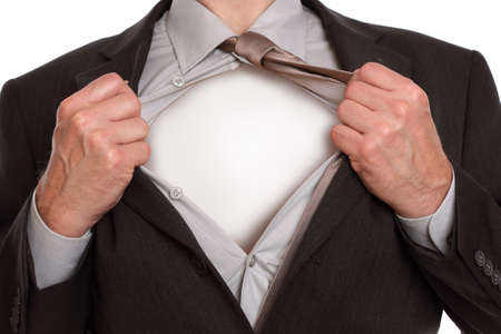 alter ego: Businessman in classic superman pose tearing his shirt open to reveal blank copy space on chest