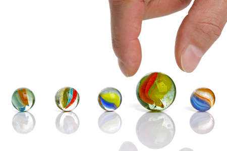 picking up: Picking up a big marble concept for choice or advantage