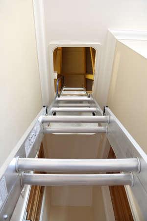 house gable: Aluminium step ladder into loft or attic space
