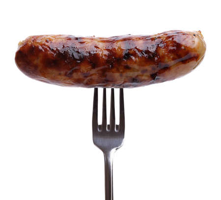 fork: Grilled sausage on a fork against white