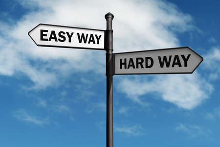 Crossroad signpost saying easy way and hard way concept for choice, confusion or decisions photo