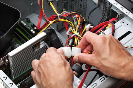 Computer engineer repairing a faulty pc photo