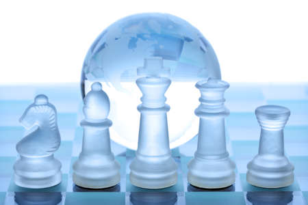 transparent globe: Glass chess pieces, board and globe concept for global business