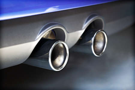 Chrome twin exhaust pipe blowing smoke fumes photo