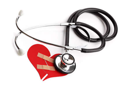 Stethoscope and broken heart concept for heart disease or illness photo