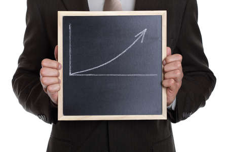 Businessman holding a blackboard with a graph showing a positive trend with space for message photo