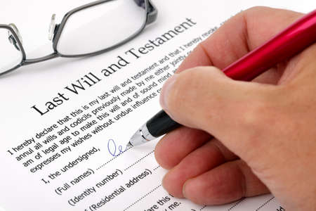 will power: Close up of hand signing a Last Will and Testament document