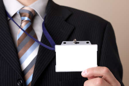 cardkey: Businessman showing a blank identity name card