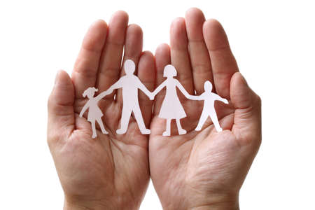 mother       care: Cutout paper chain family with the protection of cupped hands, concept for security and care Stock Photo