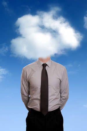 contemplation: Businessman standing with his head in the clouds concept for daydreaming, contemplation, aspirations or creativity