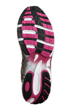 sports shoe: Sole of new fashion sport trainer isolated on white Stock Photo