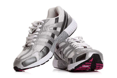 sporting equipment: New unbranded running shoe, sneaker or trainer isolated on white Stock Photo
