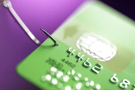 Credit card hooked on a fishing hook concept for addiction to spending with credit or internet phishing crime photo