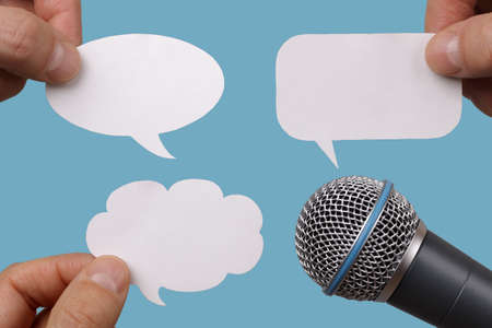 commentator: Conference, interview or social media concept with microphone and blank speech bubbles