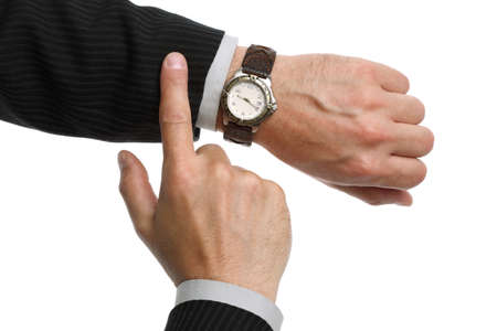 A businessman checking the time on his wrist watch Stock Photo