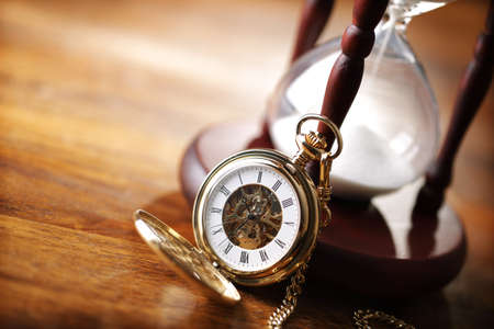 pocket watch: Hour glass or sand timer with vintage pocket watch, symbols of time with copy space