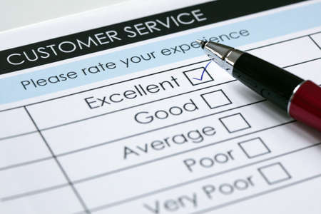 service: Tick placed in excellent checkbox on customer service satisfaction survey form