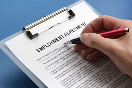 filling out: Man filling out an employment agreement contract  Stock Photo