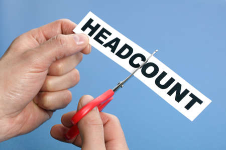 Headcount cutting concept for downsizing, job cuts and unemployment issues photo
