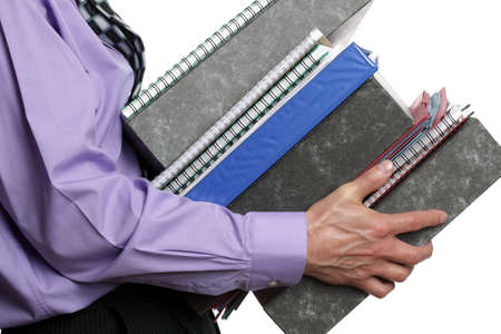 overwork: Businessman carrying a stack of files, concept for overwork, busy or multi-tasking