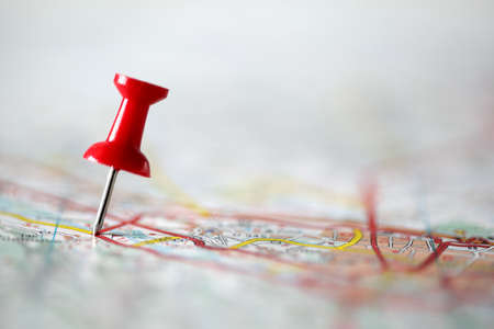 red pin: Red pushpin showing the location of a destination point on a map Stock Photo