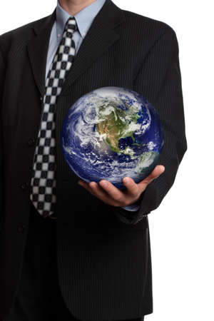 Business man holding a globe in his hand symbol for gobal business, communications or environmental conservation photo