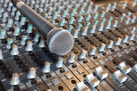recording studio: Microphone resting on a sound console in a recording studio