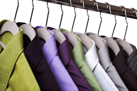 coathanger: Multi colored shirts on hangers against a white background