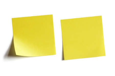 postit note: Two yellow sticky note reminders on a white background Stock Photo