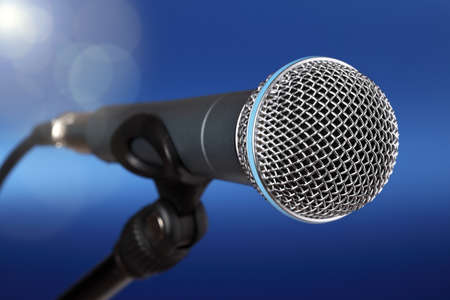 Spot light on a microphone on stage photo