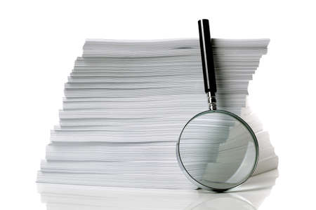 scrutinize: Magnifying glass with stack of documents