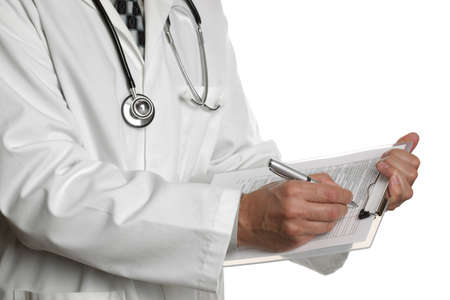 filling out: Male doctor filling out a medical document or patient examination notes Stock Photo
