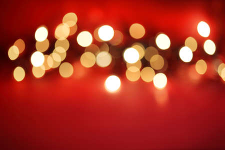 Abstract blurred white lights on red background Stock Photo