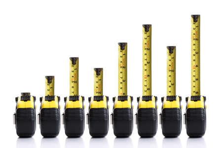 herramientas de carpinteria: Cinta métrica concepto gráfico de barras