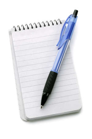 ballpoint pen: Ballpoint pen resting on a blank note pad isolated on white