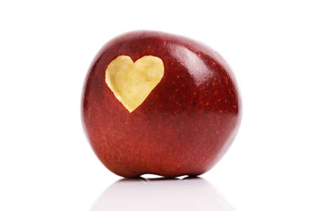 missing bite: Forbidden fruit red delicious apple with a love heart shape bitten into the flesh