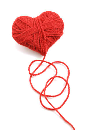 haberdashery: Red heart shape symbol made from wool isolated on white background