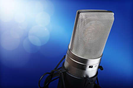 Spot light on a microphone on stage with copy space photo
