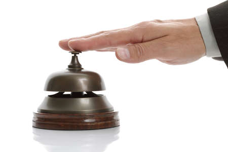 complaining: Business man hand ringing the bell for assistance