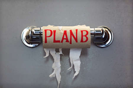 public toilet: Empty roll of toilet paper with the phrase Plan B