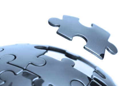 successful strategy: Last piece of a global puzzle concept for business solutions and strategy Stock Photo