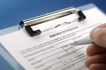 Completing an employment application form photo