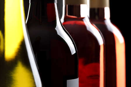 differential focus: wine bottles in a row