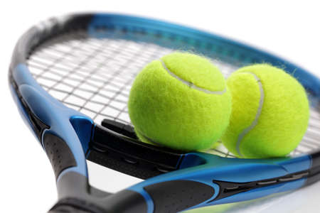 Tennis racquet and two balls on white background Stock Photo