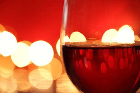 defocussed: Wineglass with red illuminated defocussed christmas light background