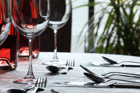 stereotypically: Restaurant table with silverware, wine and wine glasses